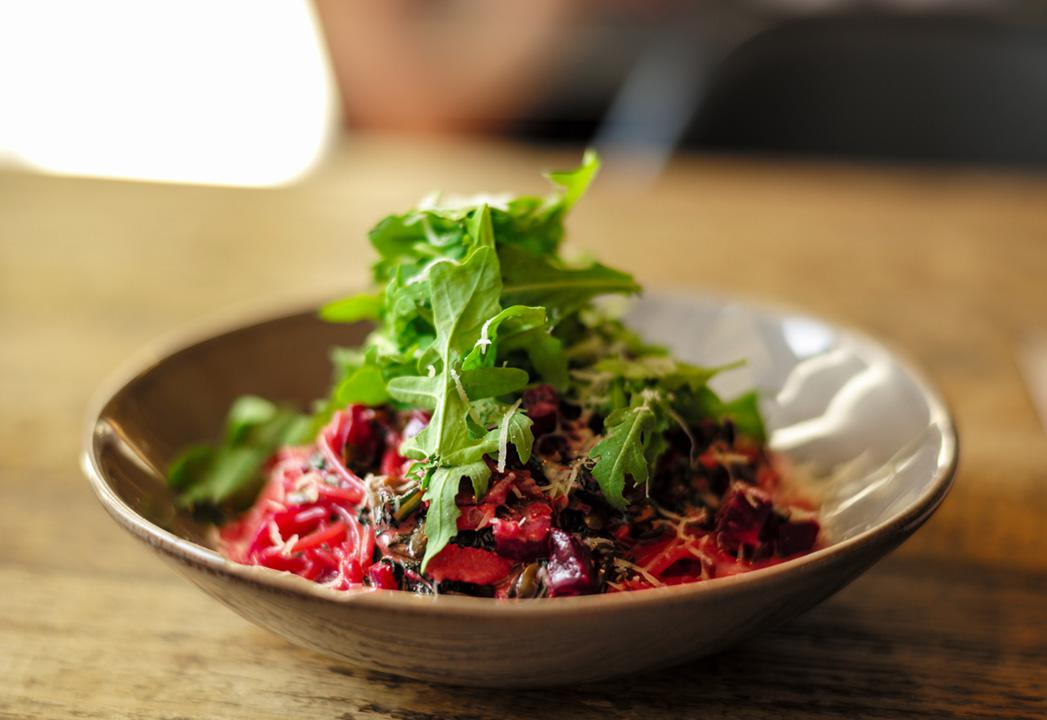 enjoy this zesty beet salad with arugula on top
